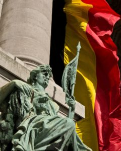 STATUE IN FRONT OF BELGIAN FLAG