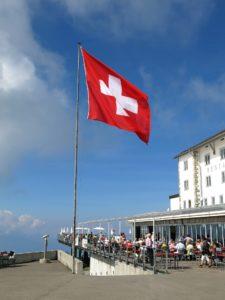 SWISS FLAG BEHIND A BLUE SKY